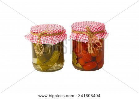Canned Vegetables. Red Tomatoes And Green Cucumbers In Brine In The Bank, Isolated