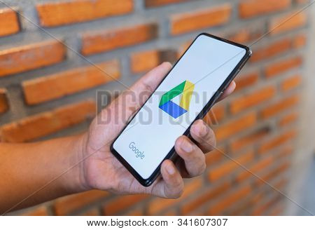 Chiang Mai, Thailand - Aug.24,2019: Man Hands Holding Xiaomi Mi Mix 3 With Google Drive Apps On Scre