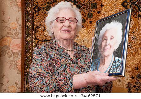 Senior Woman Shows Her Portrait