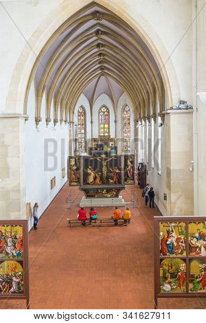 Colmar, France - July 3, 2013: People Visit The Isenheim Altarpiece, Sculpted And Painted By The Ger