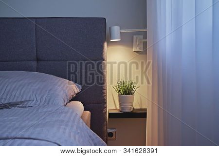 View Of Modern Minimal Style Bedroom With Beige Bedclothes And Light Wall, Copy Space