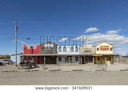 Seligman, Usa - March 19, 2019: View On Historic Wild West Facade With Livery And Tonsorial Of Doc H