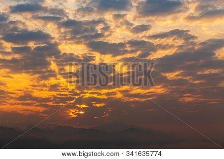 Beautiful Sunrise On Mountain. Sky And Cloudscape At Sunrise. Sunrise In Thailand.