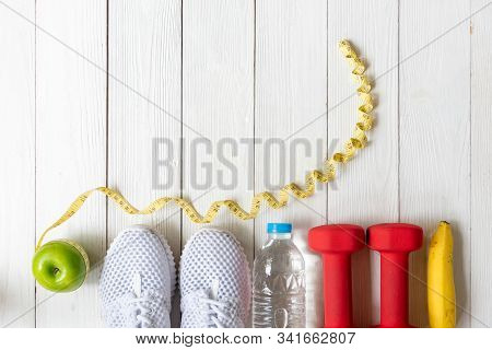 Diet And Weight Loss For Healthy Care With  Fitness Equipment, Fresh Water And Fruit Healthy, Green