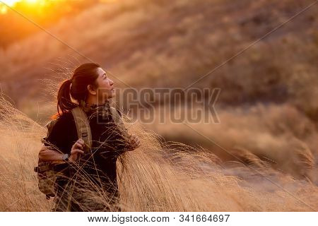 Asian Women Hiker Or Traveler With Backpack Adventure Walking Relax In The Field Meadow Outdoor For