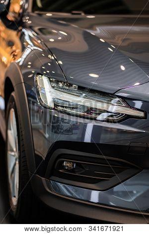 Car Detailing Series: Clean Headlights Of Gray Sports Car. Luxury Headlights. Gray Supercar. Tuning.