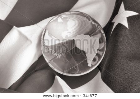 Glass Globe And American Flag In B&w