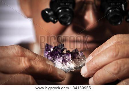 Professional Jeweler Working With Beautiful Amethyst, Closeup