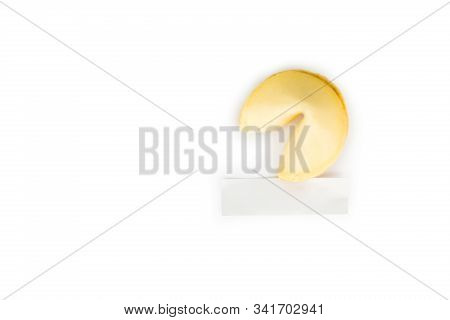 Single Fortune Cookie Camera Focus On The Blank White Paper Isolated On A Pure White Background With