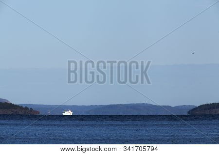 View Of The Sea, Hills In The Distance And Birds This Side. A Local Ship Crosses The Sea.
