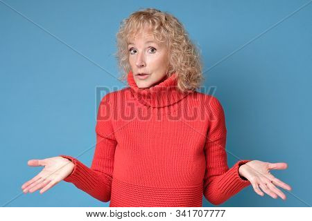 Woman Throws Up Hands Shrugging Her Shoulders Being Unsure Having Some Doubts