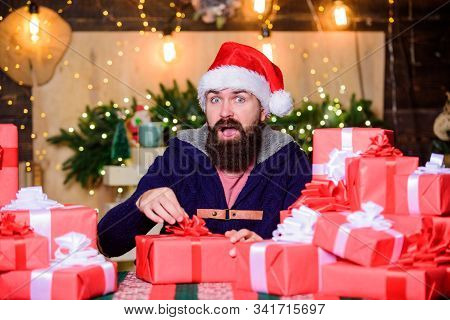 Hope For The Best. Wrapped Gifts With Ribbons And Bows. Man Bearded Santa Claus Hat Celebrate New Ye