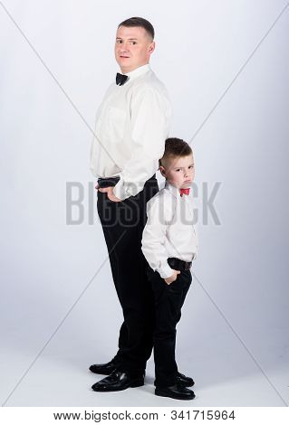 Grow Up Gentleman. Dad And Boy White Shirts With Bow Ties. Gentleman Upbringing. Little Son Followin