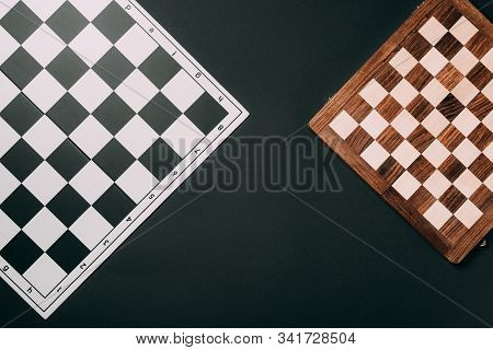 Top View Of Checkerboards Isolated On Black