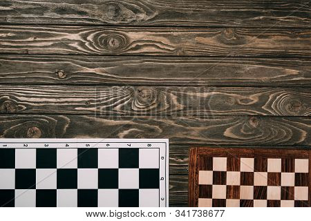 Top View Of Two Checkerboards On Wooden Background With Copy Space