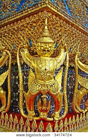 The statues of Krut battling naga serpent, a Thai Buddhist adaptation of Garuda in Wat Phra Kaeo temple, Bangkok poster