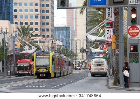 Long Beach, Ca - Nov 15, 2019: Long Beach Transit Buses And Metro Train Carrying Passengers. Downtow