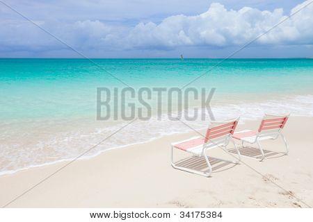 Beach chairs at beautiful tropical coast