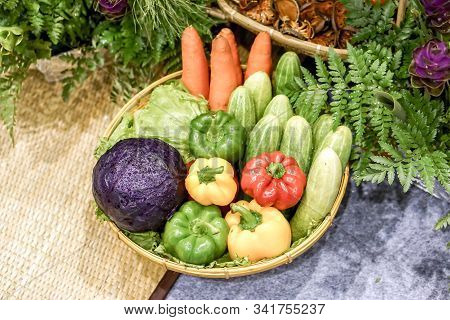 Sample Vegetables That Are Beneficial To The Body (colorful Bell Peppers, Cucumbers, Purple Cabbages