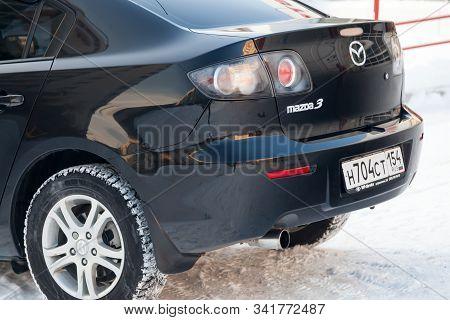 Novosibirsk, Russia - 12.26.2019: Black Mazda 3 2008 Year Rear View With Dark Gray Interior In Excel