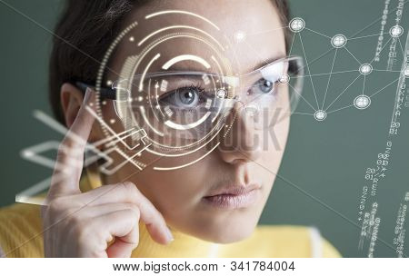 Woman In Glasses With Virtual Screen. Technologies Of The Future