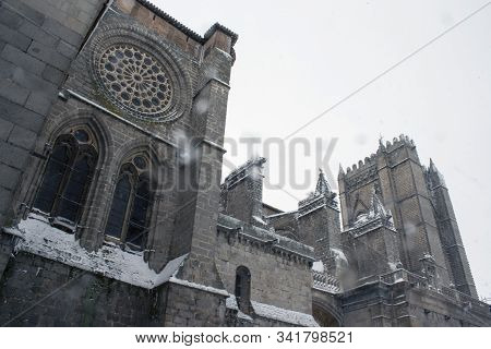 Gothic Facade Of The Cathedral At Ávila After A Winter Snowfall