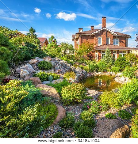 Moscow Region - Aug 24, 2019: Landscape Design Of Home Garden. Beautiful Landscaping With Small Pond