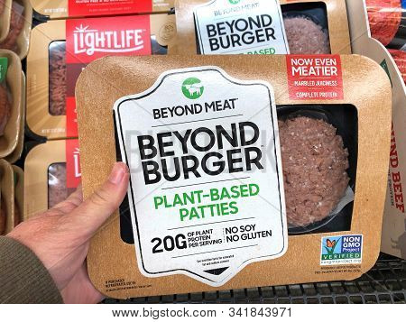 Alameda, Ca - Oct 18, 2019: Grocery Store Refrigerator Section Hand Holding Package Of Beyond Burger
