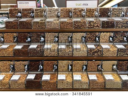 Alameda, Ca - Dec 18, 2019: Grocery Store Aisle With Self Serve Bins Containing Various Nuts And Tra