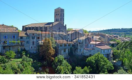 A View Of The Village Of Montolieu Aude  Languedoc - Roussillon  France. Trees Valley Ancient Houses