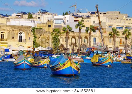 Marsaxlokk, Malta - 11. November 2019: View On The Harbour With Colorful Boats In Marsaxlokk, Malta.