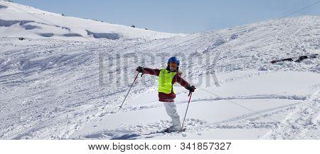 Little Skier On Snowy Ski Slope With New Fallen Snow At Sun Winter Day. Caucasus Mountains, Georgia,