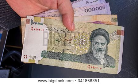 Hand Holding Iranian Rial. Rial Is The National Currency Of Iran