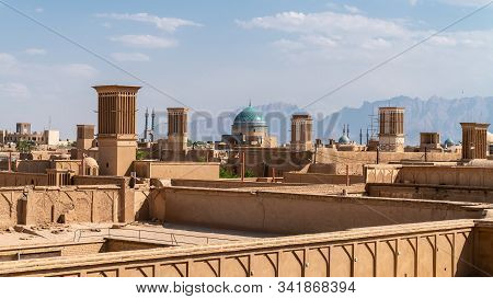 Yazd, Iran - May 2019: Yazd Cityscape With Old Brick Buildings And Badgirs Wind Catching Towers In Y