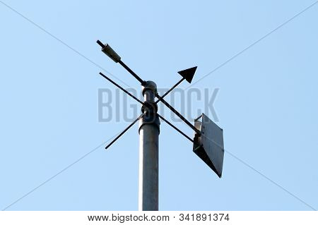 Vintage Retro Weather Vane Instrument Showing Wind Direction And Arrow Pointing Towards North Mounte