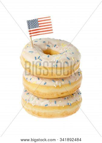 Stacked Glazed Dounts With An American Flag Isolated On White Background.