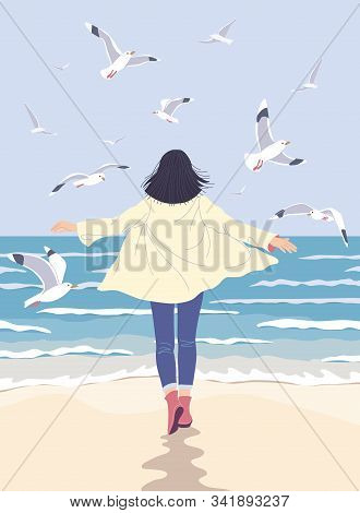 Young Woman Enjoy At The Sea Coast. Dreamy Girl Walking Along The Seaside Back View. Serenity Landsc