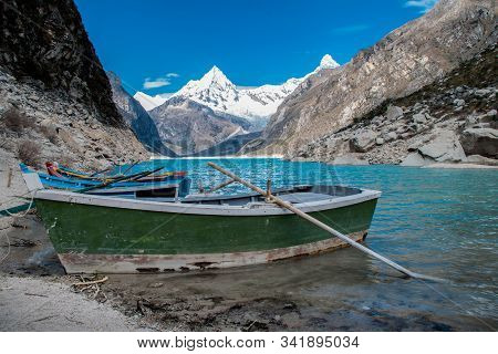 Old Boat In The Coast Of The Beautiful Lake Paron. Behind You Can See The Piramide Mountain. Cordill