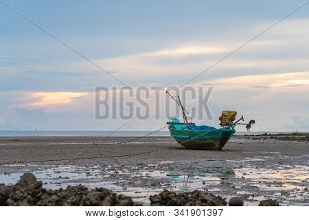 Fishing Boat Parking On Shore During Morning In Sunny Day
