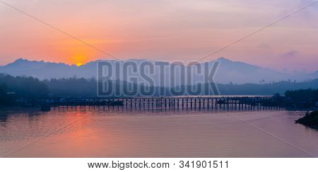 Panarama Beautiful View Of Mon Wooden Bridge In Fog Environment In Early Morning During Sunrise In S