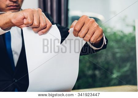 Business Man Angry Breaking Tearing Paper Document On Desk Office