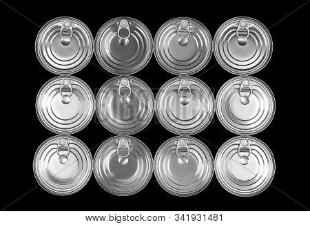 Close Up Photo Of Aluminium Cans In A Raw Isolated On Black Background. Aluminium Can Background. Ca