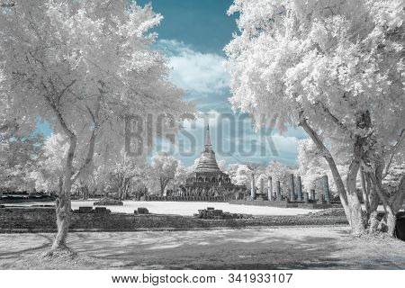 Ruined Ancient Buddhist Temple And Pagoda In Srisatchanalai Historical Park, Sukhothai, Thailand In