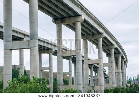 Architecture Lines Under The Highway Bridge,concrete Pillars Or Trestle Under The Viaduct With Green