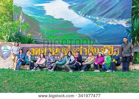 Lamphun Thailand - December 9 :  Group Of Tourists Take Pictures With National Park Sign On December