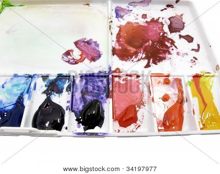 Paintbrush On Art Palette With Blobs