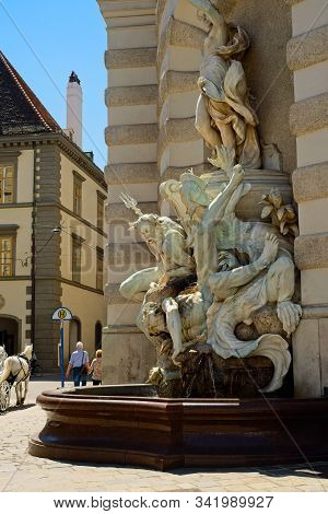 Vienna, Austria - June 4, 2019: Poseidon And Other Mythical Figures Make Up An Elaborate Statue At O