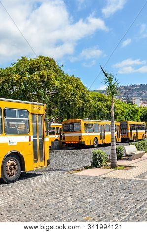Funchal, Madeira, Portugal - Sep 10, 2019: Main Station Terminal With Yellow Buses In The Madeiran C