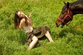 portrait of attractive girl and horse. outdoor shot poster
