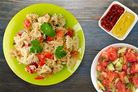 Pasta On A Plate. Pasta Tomatoes, Onions, Cabbage On A Wooden